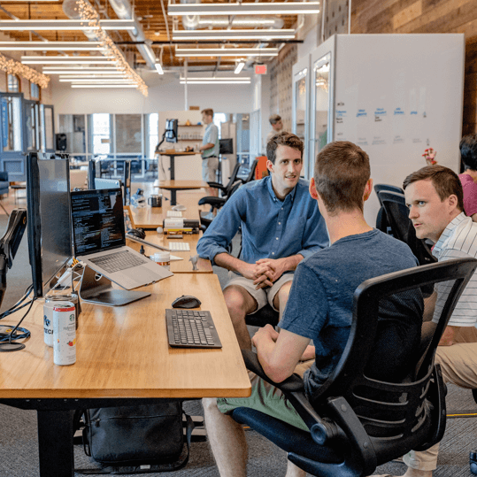 image of a team of young people working together in a modern office